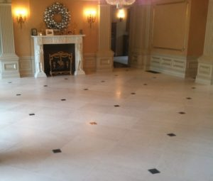 Cream martial floor with serpentine green marble inserts. Wellesley, MA
