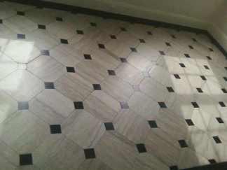 Travertine floor with Black Absolute granite tile