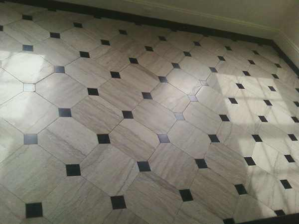Travertine floor with Black Absolute granite tile