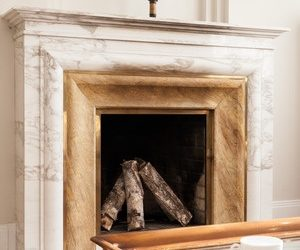 When is the best time to clean a stone fireplace?